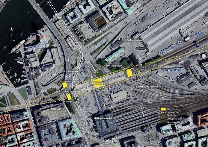 Satellitbild över centrala Göteborg med tilltänkt dragning för Västlänken inritat.